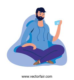 young man using smartphone seated in sofa