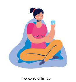 young woman using smartphone seated in sofa