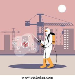 man in suit disinfecting machines and buildings