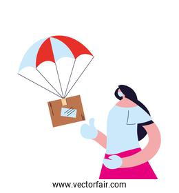 woman receiving package with safety precautions, face mask and gloves