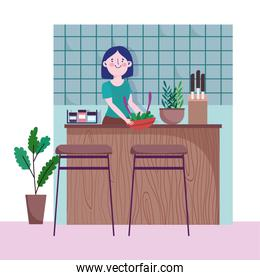 people cooking, woman with vegetables in bowl counter kitchen