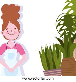 people cooking, woman with apron and potted plant