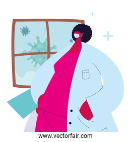 Female doctor with mask and gown to prevent coronavirus