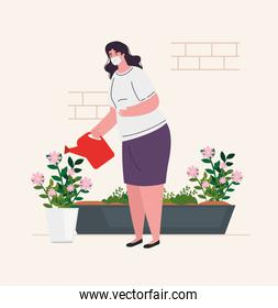 woman wearing medical mask, watering the plants