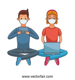 young couple wearing medical masks using technology seated
