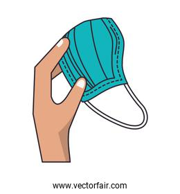 hand with blue medical mask protection accessory