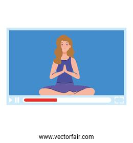 online, yoga concept, woman practices yoga and meditation, watching a broadcast on a web page