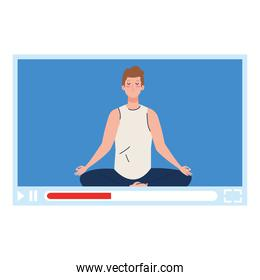 online, yoga concept, man practices yoga and meditation, watching a broadcast on a web page
