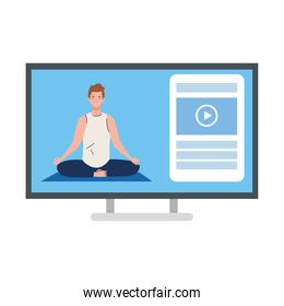 online, yoga concept, man practices yoga and meditation, watching a broadcast on a computer