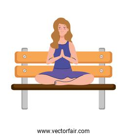 woman meditating sitting in park wooden chair, concept for yoga, meditation, relax, healthy lifestyle