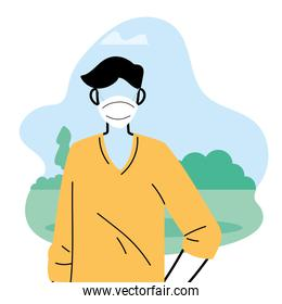 Young man wearing face mask to prevent virus in the park