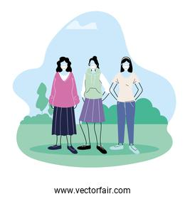 Young women wearing face masks to prevent virus in the park