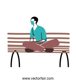 man in park sitting with mask on