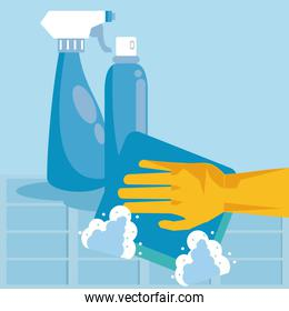 disinfect and clean activity with splash bottles and hand using squeegee