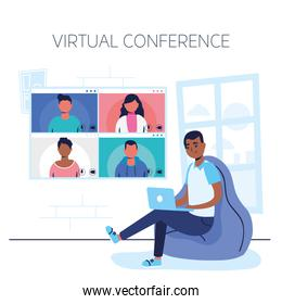 afro man using laptop in virtual conference communication