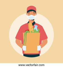 safe food delivery worker with groceries box