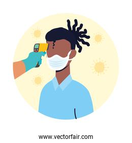 check temperature with laser thermometer to afro male patient