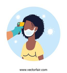 check temperature with laser thermometer to afro female patient