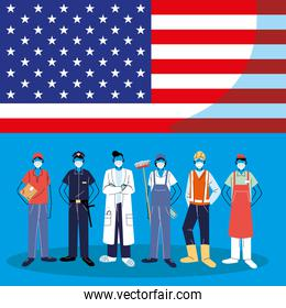 Frontline workers wearing face masks standing with American flag