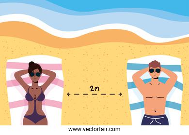 interracial couple on the beach practicing social distancing scene ,summer time vacations