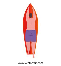 man of back in lying down on surfboard with shorts purple color on white background