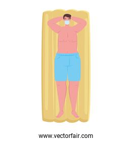 man in shorts blue color, wearing medical mask in lying down on inflatable float, covid 19 summer vacation
