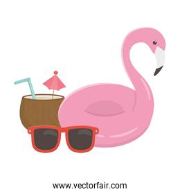 summer travel and vacation float flamingo sunglasses and cocktail