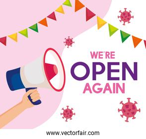 open again after quarantine,reopening of shop,we are open again lettering with megaphone and garlands hanging
