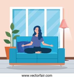 stay home, be safe, woman meditating in the living room, sitting in couch, during coronavirus covid 19, stay at home quarantine, be careful