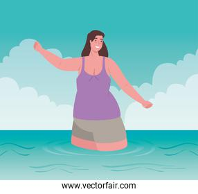 cute plump woman in swimsuit, happy in the sea, summer vacation season