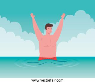 man in sea with hands up, happy guy in the beach, summer vacation season