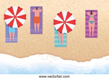 view aerial, people on the beach, women and men sunbathing on the beach, summer vacation season