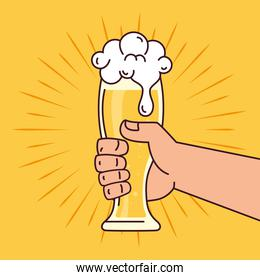 hand holding a beer glass, on yellow background