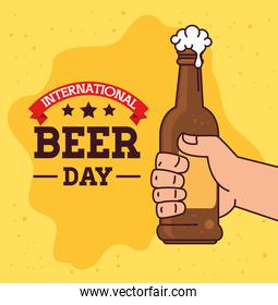 international beer day, august, hand with bottle beer