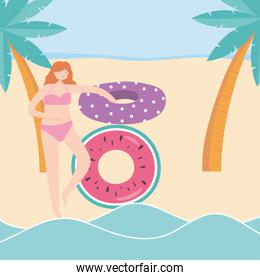 summer time girl with floats and palm s beach vacation tourism