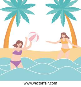 summer time vacation tourism girls playing in sea with beach ball