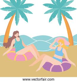 summer time vacation tourism women sitting on swimming ring in sand beach