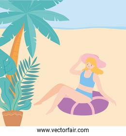 summer time woman sitting on inflatable rubber ring beach vacation tourism