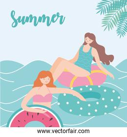 summer time beach vacation women resting on floating rubber rings on sea