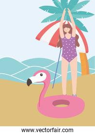 summer time vacation tourism woman with umbrella flamingo float in beach