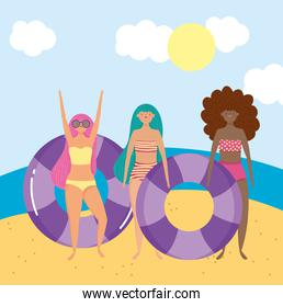 summer people activities, girls with floats in the beach, seashore relaxing and performing leisure outdoor