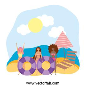 summer people activities, cheerful girls with floats chair and umbrella, seashore relaxing and performing leisure outdoor