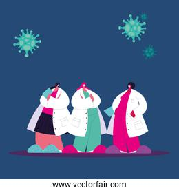 Female doctors with masks and gowns to prevent coronavirus