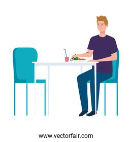 man sitting in chair, with food in table, on white background