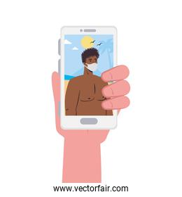Hand holding smartphone and man with mask at the beach in video chat vector design