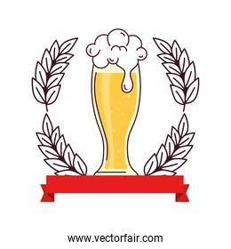 glass of beer with ribbon decoration and spike on white background