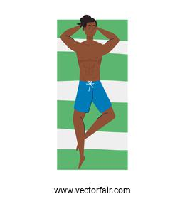 view aerial, man afro in shorts lying down, tanning on towel