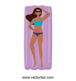 woman afro in lying down on inflatable float with swimsuit, summer vacation season