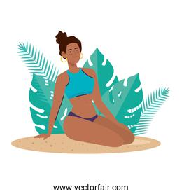woman afro with swimsuit sitting on the beach with tropical leaves decoration, summer vacation season