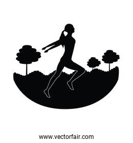 silhouette of athletic woman running in the camp